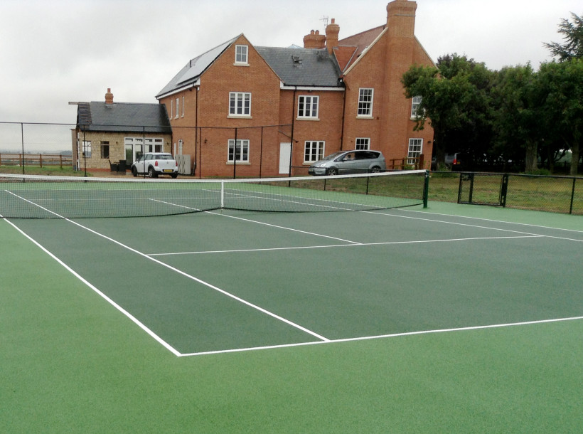 Two-tone green private tennis court