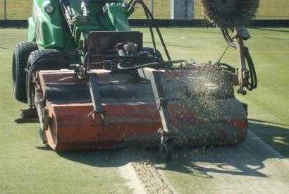The old sand infill is removed using specialist equipment