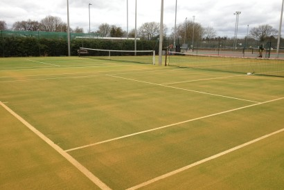 Finished synthetic grass tennis court at a tennis club
